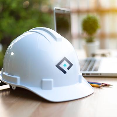 Pearce Homes Builders Helmet on planning desk